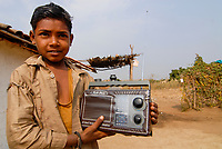 INDIA, Madhya Pradesh , boy with radio in village