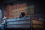 MARIUPOL, Ukraine: The transport of the material has decreased due to the rail trail destroyed by shelling. <br /> Here, a worker in a truck travelling around the factory. <br /> <br /> MARIUPOL, Ukraine: Le transport de la matière a diminué en raison des rails de train détruits par les bombardements.<br /> Ici, un travailleur dans un camion circulant dans l'usine.