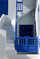 Paros, Greek Islands, Parikia, Cyclades, Greece, Europe, Typical home with whitewashed steps with blue railing and blue gate n Parikia on Paros Island.
