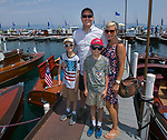 The Pilcher family during the Concours d'Elegance Wood Boat Show at Lake Tahoe on Friday, August 10, 2018.