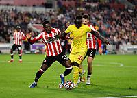 25th September 2021; Brentford Community Stadium, London, England; Premier League Football Brentford versus Liverpool; Sadio Mane of Liverpool being challenged Shandon Baptiste of Brentford