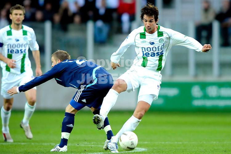 voetbal fc groningen - ajax erediivisie seizoen 2007-2008 16-04-2008  .rasmus lindgren uitgespeeld door goran lovre.fotograaf Jan Kanning