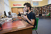 A volunteer librarian at Friern Barnet library, which has been restocked and reopened as The People's Library and community hub by activists and local residents.