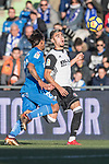 Damian Nicolas Suarez Suarez of Getafe CF in action against Zakaria Bakkali of Valencia CF during the La Liga 2017-18 match between Getafe CF and Valencia CF at Coliseum Alfonso Perez on December 3 2017 in Getafe, Spain. Photo by Diego Gonzalez / Power Sport Images