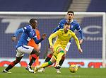 26.12.2020 Rangers v Hibs: Martin Boyle with Glen Kamara and Leon Balogun