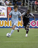 Colorado Rapids midfielder Wells Thompson (15) preparing to pass the ball back down the field with New England Revolution midfielder Sainey Nyassi (14) in pursuit.  The Colorado Rapids defeated the New England Revolution, 2-1, at Gillette Stadium on April 24.2010