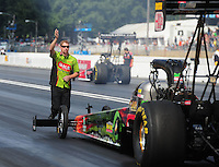 Aug. 7, 2011; Kent, WA, USA; A crew member for NHRA top fuel dragster driver Terry McMillen backs him up during the Northwest Nationals at Pacific Raceways. Mandatory Credit: Mark J. Rebilas-