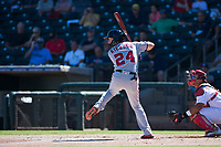 Salt River Rafters shortstop Carter Kieboom (24), of the Washington Nationals organization, at bat in front of catcher Jeremy Martinez (4) during an Arizona Fall League game against the Surprise Saguaros on October 9, 2018 at Surprise Stadium in Surprise, Arizona. The Rafters defeated the Saguaros 10-8. (Zachary Lucy/Four Seam Images)