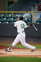 Clinton LumberKings shortstop Rayder Ascanio (13) follows through on a swing during a game against the Lansing Lugnuts on May 9, 2017 at Ashford University Field in Clinton, Iowa.  Lansing defeated Clinton 11-6.  (Mike Janes/Four Seam Images)