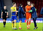 St Johnstone v Hibs…23.01.21   Hampden     BetFred Cup Semi-Final<br />Liam Craig celebrates with Zander Clark and Jason Kerr and Chris Kane at full time<br />Picture by Graeme Hart.<br />Copyright Perthshire Picture Agency<br />Tel: 01738 623350  Mobile: 07990 594431