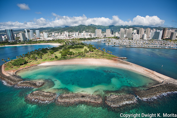 Aerial view of the man-made lagoon at the end of Magic Island, at the eastern end of Ala Moana Park. This part of the park is the subject of discussion to be renamed in honor of Barack Obama by his hometown, Honolulu. The Ala Wai Yacht Harbor is to the right and the Ala Moana Shopping Center is to the left.