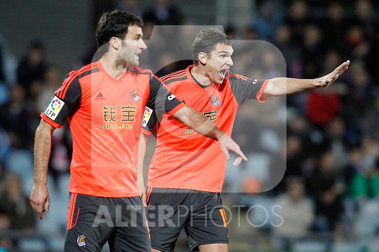 Real Sociedad's Imanol Agirretxe (l) and Jon Ansotegi during La Liga match.March 16,2015. (ALTERPHOTOS/Acero)