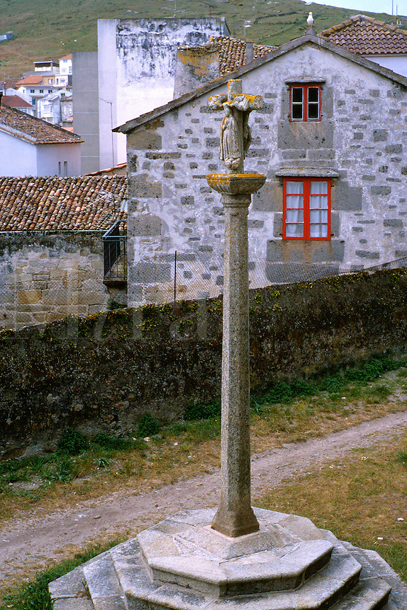 Spain, Galicia, Camarinas. Village scene typical for a Galician coastal city. Especially indicative of Galicia is the cross with Mary on the side opposite of Christ on the cross.