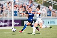 CARY, NC - SEPTEMBER 12: Merritt Mathias #11 of the NC Courage defends against Sophia Smith #9 of the Portland Thorns during a game between Portland Thorns FC and North Carolina Courage at Sahlen's Stadium at WakeMed Soccer Park on September 12, 2021 in Cary, North Carolina.