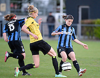 20140502 - VARSENARE , BELGIUM : Lierse's Justine Vanhaevermaet (m) pictured with Brugge's Amber De Priester (r) and Celine Vandekerkhove (l) during the soccer match between the women teams of Club Brugge Vrouwen  and WD Lierse SK  , on the 26th matchday of the BeNeleague competition on Friday 2 May 2014 in Varsenare .  PHOTO DAVID CATRY