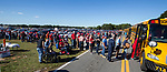 PENSACOLA, FL - NOVEMBER 03: The line to board the 20 busses to the President Donald J. Trump's Make America Great Again Rally in a hanger at the Pensacola International Airport on November 3, 2018 in Pensacola, Florida. President Trump is campaigning in support of Republican candidates in the upcoming midterm elections. (Photo by Mark Wallheiser/Getty Images)