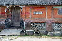 Bali, Indonesia.   Private House with Guardian Demons (Dvarapala or Dwarapala) on either side of the Doorway.  Tenganan Village.