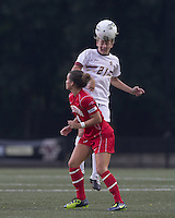 Boston College forward/midfielder Kate McCarthy (21) heads the ball. After 2 complete overtime periods, Boston College tied Boston University, 1-1, after 2 overtime periods at Newton Soccer Field, August 19, 2011.