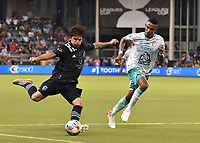 KANSAS CITY, KS - AUGUST 10: Grayson Barber #19 of Sporting Kansas City gets a shot off past William Tesillo #6 of Club Leon FC during a game between Club Leon FC and Sporting KC at Children's Mercy Park on August 10, 2021 in Kansas City, Kansas.