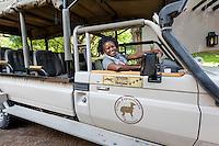 Africa, Botswana, Kasane, Chobe Game Lodge, Chobe National Park. Malebogo Lebo Kgoleng, One of Chobe Game Lodge women guides in her vehicle.