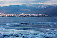 Winter at Lake Suwa, with warm water from a hidden hot spring bubbling up through the ice, Nagano, Japan.
