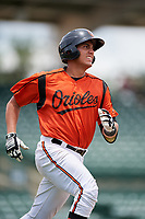 GCL Orioles catcher Alfredo Gonzalez (34) runs to first base during a game against the GCL Rays on July 21, 2017 at Ed Smith Stadium in Sarasota, Florida.  GCL Orioles defeated the GCL Rays 9-0.  (Mike Janes/Four Seam Images)