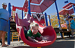 3-year-old Luke Lowden tries out the new slide during the grand opening of Inspiration Station, located at Dick Taylor Park in Reno.  The Junior League of Reno and the City of Reno celebrated the opening of the regions only universally accessible playground on Saturday afternoon, October 20, 2012.