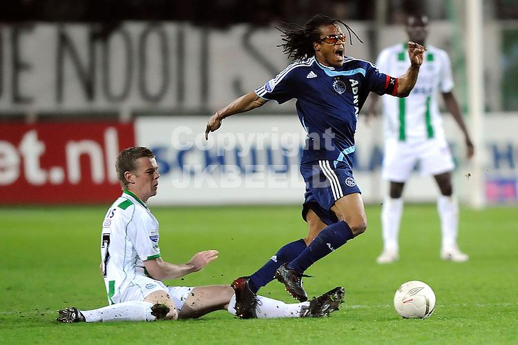 voetbal fc groningen - ajax erediivisie seizoen 2007-2008 16-04-2008  .jeroen veldmate met edgar davids.fotograaf Jan Kanning