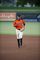 AZL Giants center fielder Heliot Ramos (31) jogs off the field between innings of the game against the AZL Athletics on August 5, 2017 at Scottsdale Stadium in Scottsdale, Arizona. AZL Athletics defeated the AZL Giants 2-1. (Zachary Lucy/Four Seam Images)