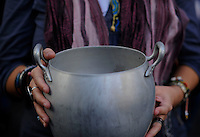 "A demonstrator holds a casserole as he takes part in a ""casserole march"" against government's austerity reforms and the public payment of bank's debts on October 13, 2012 in Madrid. © Pedro ARMESTRE"