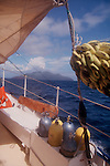 Galapagos Islands, Ecuador, Pacific Ocean, Dive Boat under sail approaching the Galapagos Islands with bananas and scuba tanks on deck.
