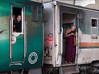 Life at the Yangon Railway Station, Yangon, Myanmar, Burma Everybody is using cell phones now,