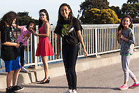 A group of young girls visiting the San Leadro Marina Park along San Francisco Bay.