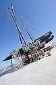 """Louis Vuitton Trophy La Maddalena 21 maggio 2010. Un solo giorno ancora e cominceranno  le regate. Le quattro barche su cui si disputerà il Trophy sono ancora a terra nella """"zona tecnica"""""""