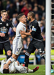 Lucas Vazquez of Real Madrid fights with Sidnei Rechel da Silva Junior of RC Deportivo La Coruna as Alvaro Morata of Real Madrid lies injured on the pitch during the La Liga match between Real Madrid and RC Deportivo La Coruna at the Santiago Bernabeu Stadium on 10 December 2016 in Madrid, Spain. Photo by Diego Gonzalez Souto / Power Sport Images