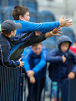 170719 | The 148th Open - Wednesday Practice<br /> <br /> Young boys catch a ball from a player at the 18th green during practice for the 148th Open Championship at Royal Portrush Golf Club, County Antrim, Northern Ireland. Photo by John Dickson - DICKSONDIGITAL