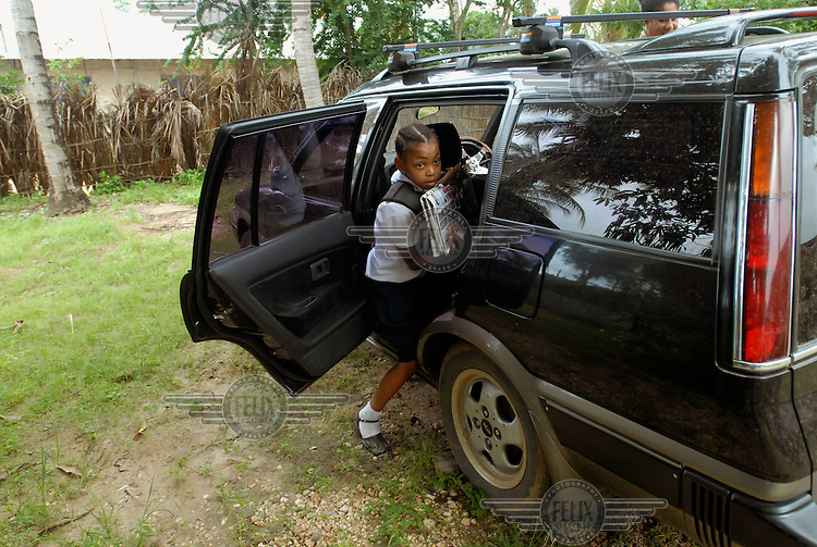 Eight year old Grace Makene is collected from the bus stop by her grandmother. It takes Grace two hours to get home from school on the public bus...