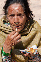Nepal, Kathmandu.  Old Woman with Nose Ring and Nose Pin, Eating.