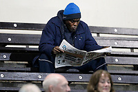 A fan deep into their paper during the Greene King IPA Championship match between London Scottish Football Club and Yorkshire Carnegie at Richmond Athletic Ground, Richmond, United Kingdom on 1 November 2019. Photo by Carlton Myrie / PRiME Media Images