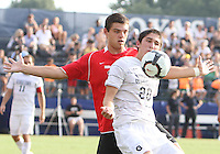 Andy Riemer #20 of Georgetown University shields the ball from Don Anding #12 of Northeastern University during an NCAA match at North Kehoe Field, Georgetown University on September 3 2010 in Washington D.C. Georgetown won 2-1 AET.