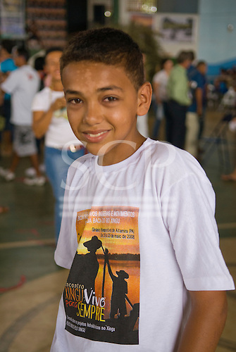 """Altamira, Brazil. """"Xingu Vivo Para Sempre"""" protest meeting about the proposed Belo Monte hydroeletric dam and other dams on the Xingu river and its tributaries. A non-Indian boy with Xingu Alive forever t-shirt."""