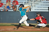 Justin Fox (2) (Erskine College) of the Mooresville Spinners follows through on his swing against the Lake Norman Copperheads at Moor Park on July 6, 2020 in Mooresville, NC.  The Spinners defeated the Copperheads 3-2. (Brian Westerholt/Four Seam Images)
