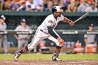 Baltimore Orioles center fielder Adam Jones #10 swings at a pitch during a game against the New York Yankees at Oriole Park at Camden Yards August 11, 2014 in Baltimore, Maryland. The Orioles defeated the Yankees 11-3. (Tony Farlow/Four Seam Images)
