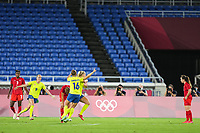 YOKOHAMA, JAPAN - AUGUST 6: Stina Blackstenius #11 of Sweden celebrates scoring with her teammates during a game between Canada and Sweden at International Stadium Yokohama on August 6, 2021 in Yokohama, Japan.