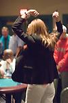 Erica Schoenberg celebrates winning a hand.