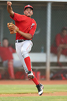 Juan Moreno #6 of the AZL Angels makes a leaping throw to first base during a game against the AZL Indians at the Cleveland Indians Spring Training Complex on July 13, 2014 in Goodyear, Arizona. AZL Angels defeated the AZL Indians, 6-5. (Larry Goren/Four Seam Images)