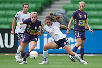 MELBOURNE, AUSTRALIA - DECEMBER 18: Carys HAWKINS of the Glory and Ashley Brown of the Victory compete for the ball during the round 7 W-League match between the Melbourne Victory and the Perth Glory at AAMI Park on December 18, 2010 in Melbourne, Australia. (Photo Sydney Low / asteriskimages.com)