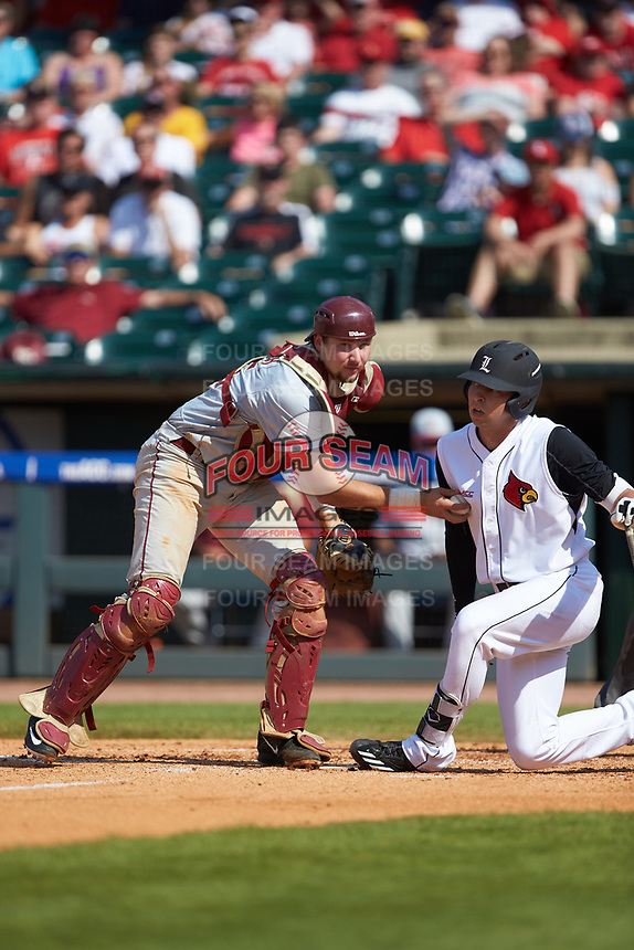Cal Raleigh (35) of the Florida State Seminoles tags out Drew Ellis (10) of the Louisville Cardinals in Game Eleven of the 2017 ACC Baseball Championship at Louisville Slugger Field on May 26, 2017 in Louisville, Kentucky. The Seminoles defeated the Cardinals 6-2. (Brian Westerholt/Four Seam Images)