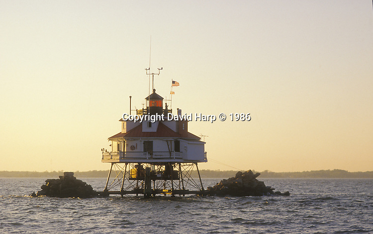 """Thomas Point Lighthouse near  the mouth of the South River on Chesapeake Bay.  Petty Office Remaly was the last USCG """"keeper"""" stationed at the lighthouse.   It was automated and the 4th order Fresnel Lens removed in 1986.  It is now automated and the Fresnel lens was replaced with a plastic modern beacon."""