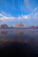 Sunrise and fog rising over the Yamuna River with the Taj Mahal, Agra India